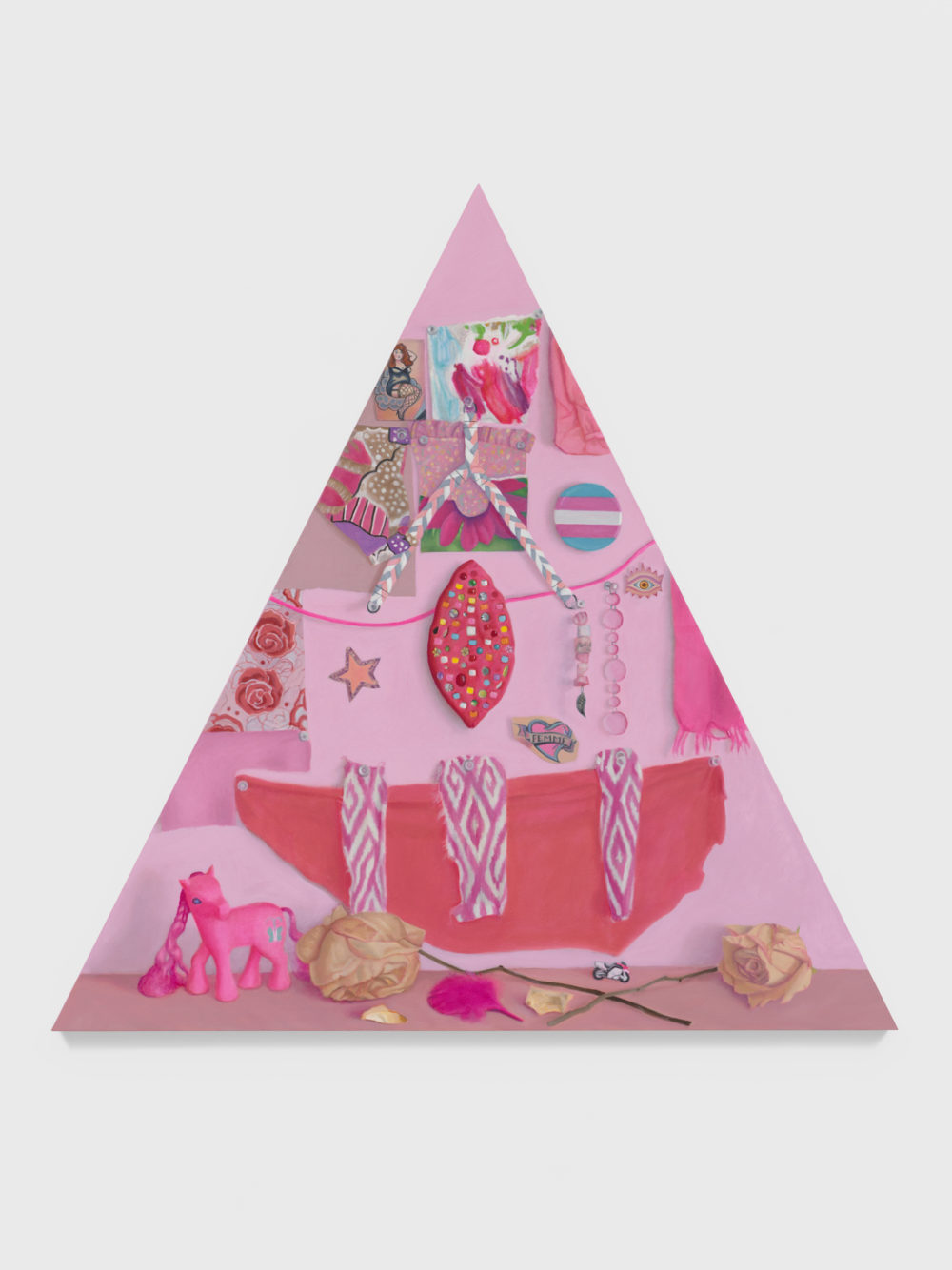 Pink triangle shaped canvas with altar items.