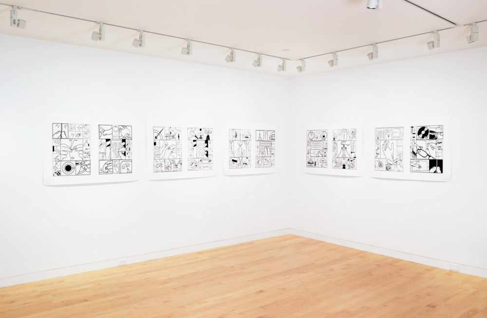 Five black and white artworks on gallery wall