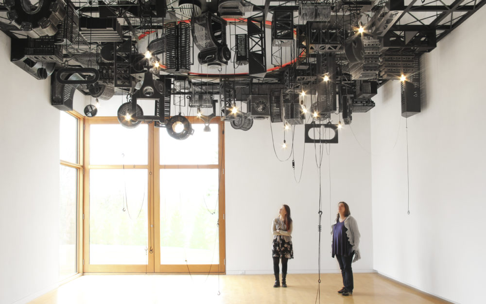 Audio equipment hangs from the ceiling