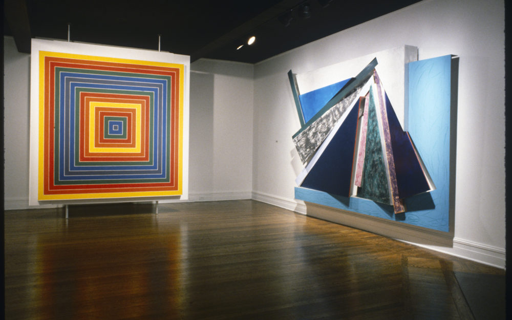 Two large paintings in a gallery