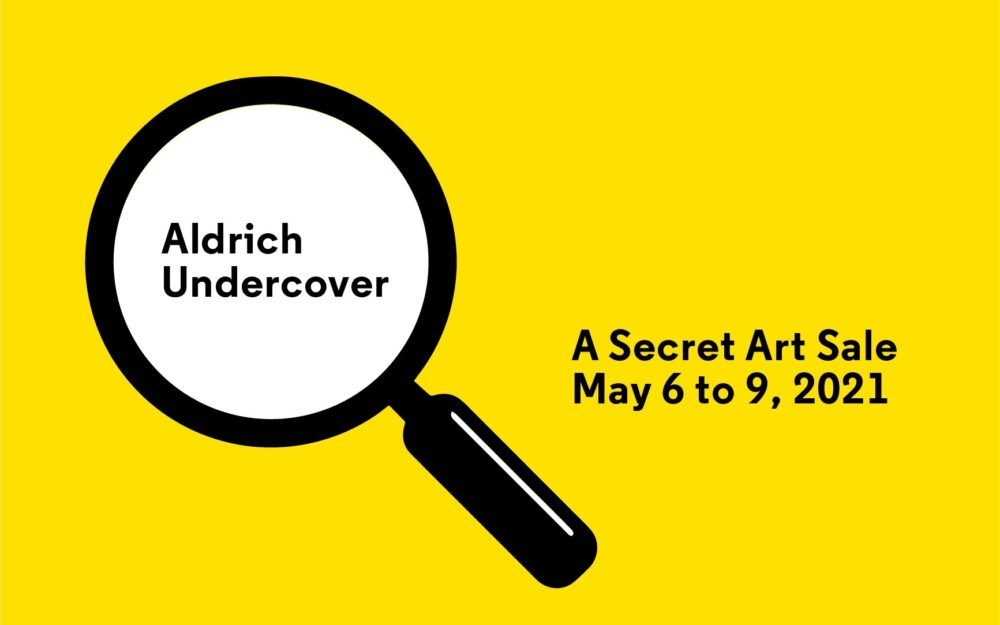 Graphic with a yellow background with a magnifying glass hovering over the words Aldrich Undercover.