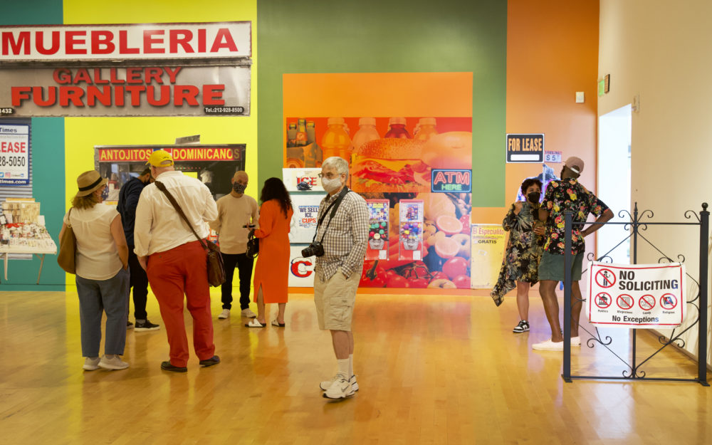 People in a colorful gallery