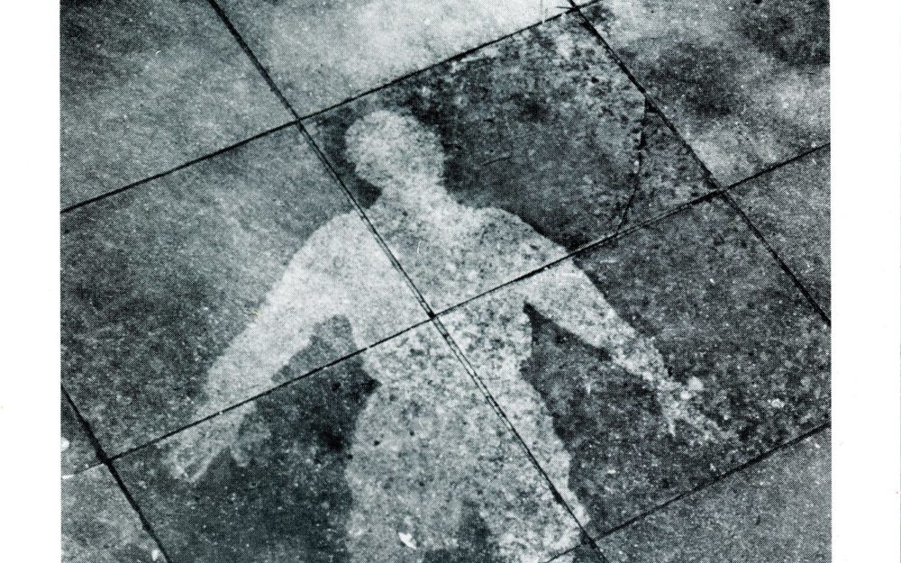 Silhouette of a body on the ground