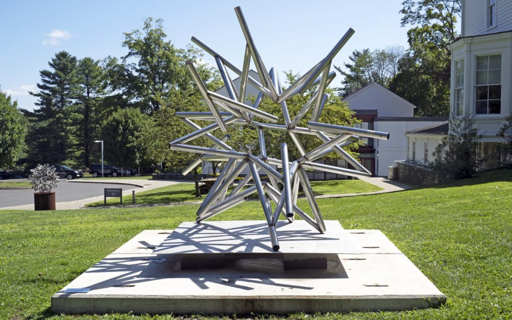 Stainless steel sculpture in form of abstract star by Frank Stella set in the lawn by Main Street in Ridgefield, CT in front of the Museum.