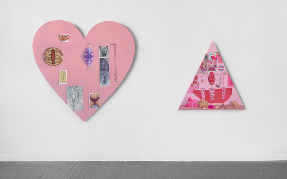 Two shaped canvases, to the left a pink heart, to the right a pink triangle, with tromp l'oeil images,