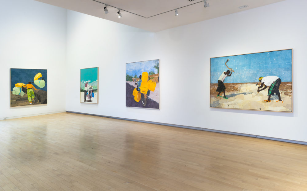 Four large canvas works on white gallery walls