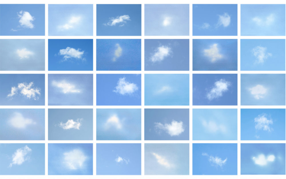 Panels of white clouds against a blue background