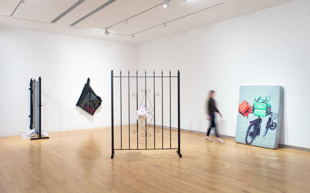Gallery with two large metal gate sculptures