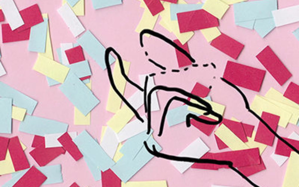 Animated hand against a pick background with shredded pieces of colorful paper