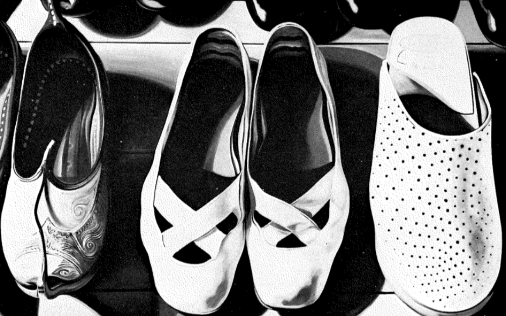 Three pairs of shoes, black and white print