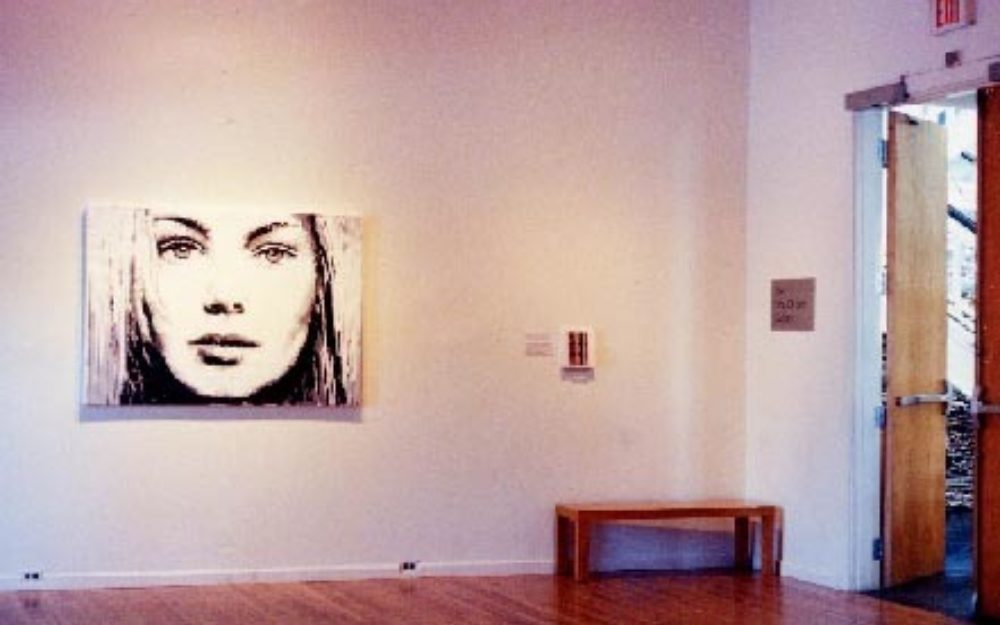 Portrait image on white gallery wall