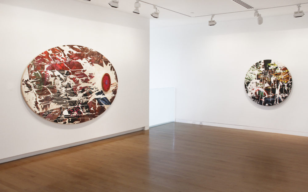Two oval works on gallery walls