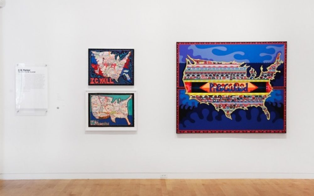 Three of Erik Parker's lyrical maps of the United States mounted on the gallery wall