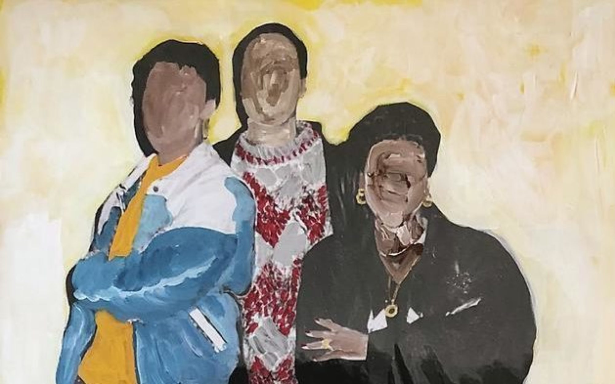 Three figures stand together with their arms crossed