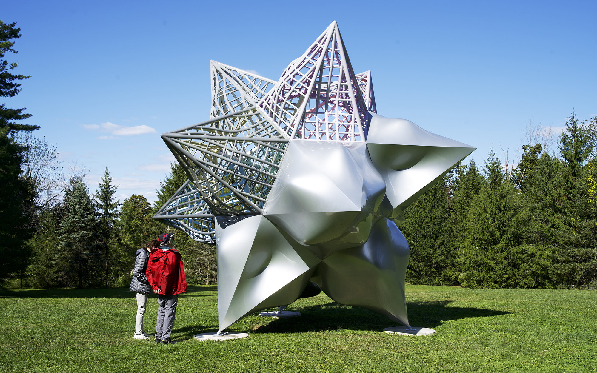 Visitors in the Museum's Sculpture Garden admire Frank Stella's work