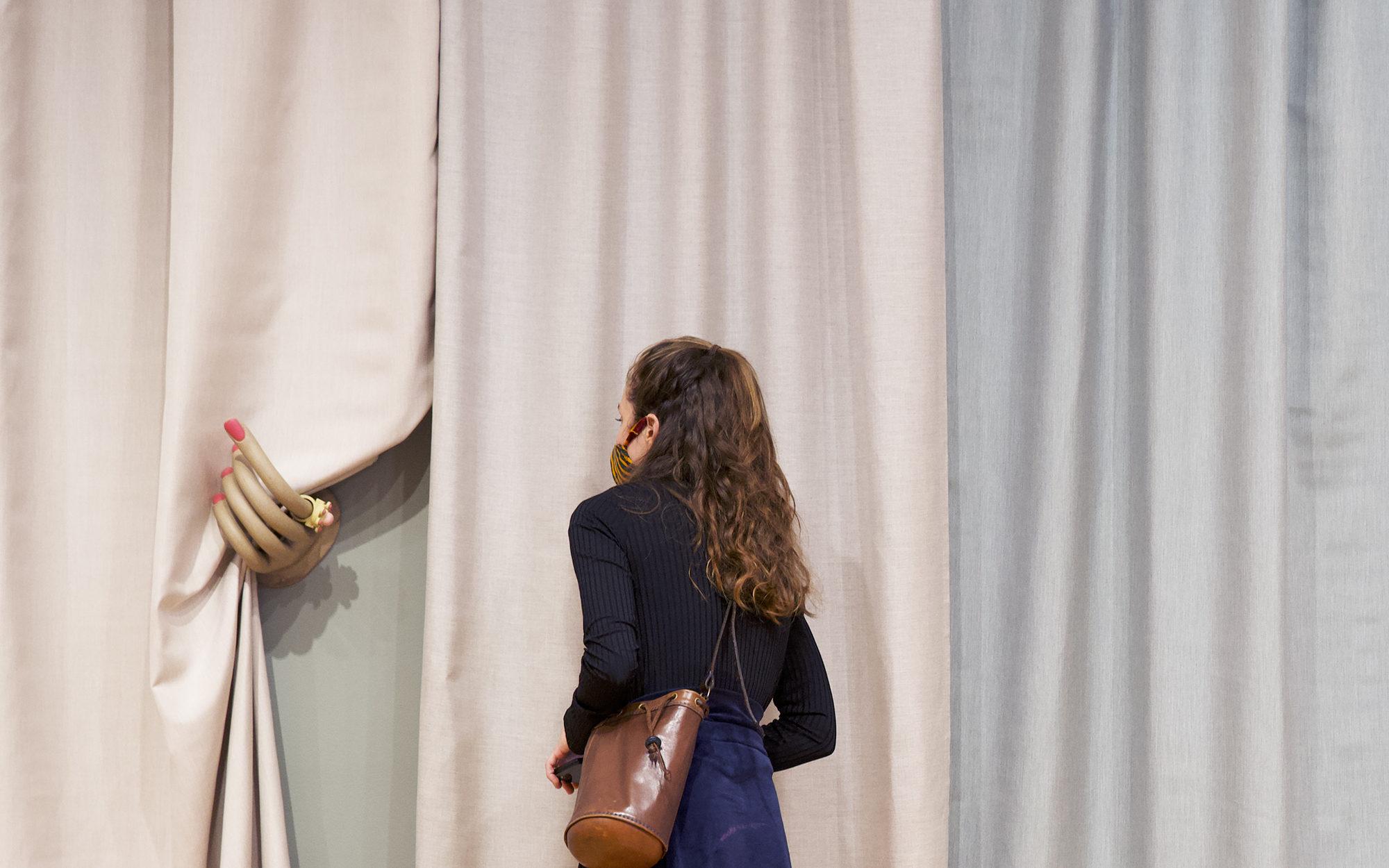Visitor views Genesis Belanger's work