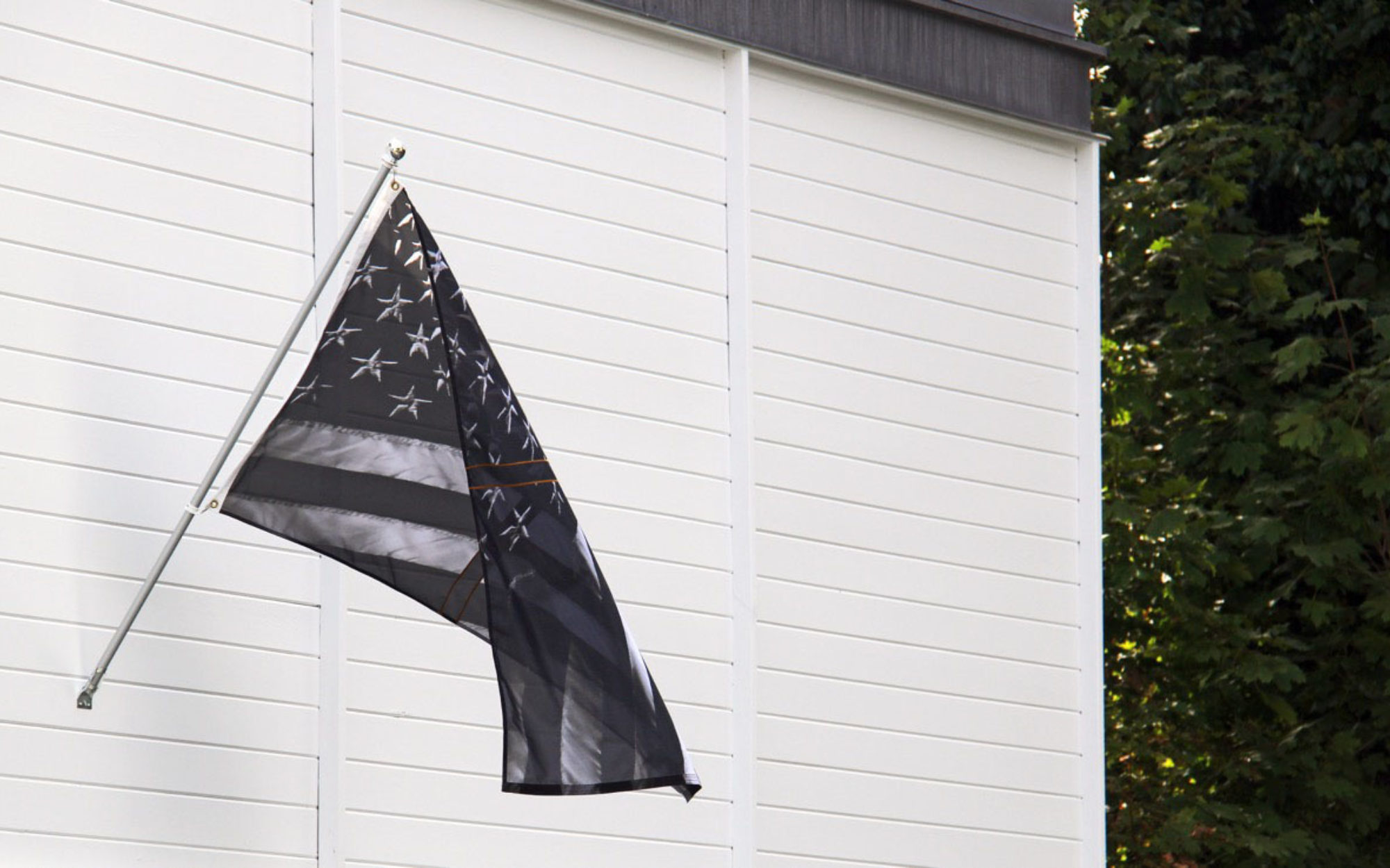 Black American flag hangs on Thee Aldrich's building