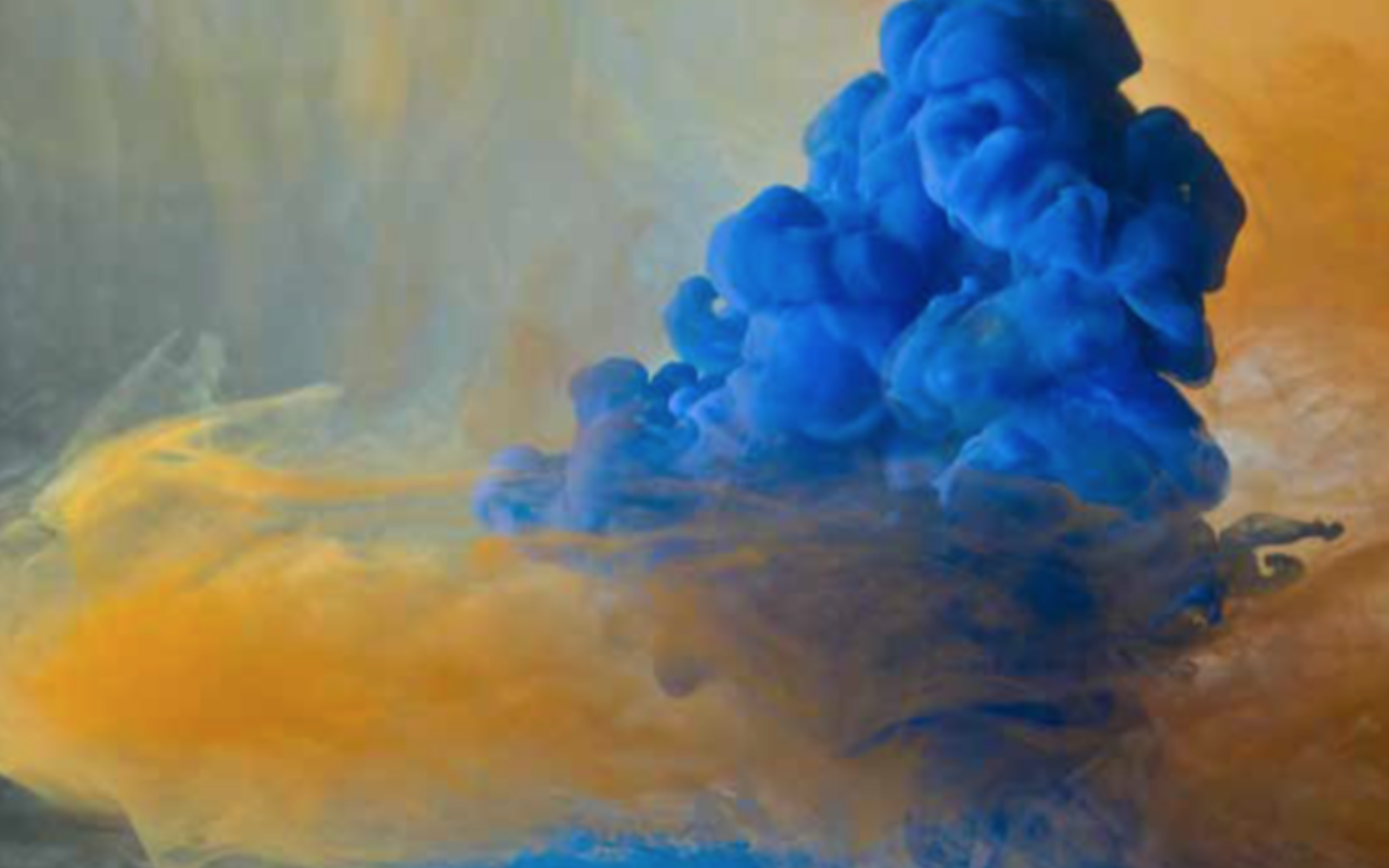 Blue cloud of paint against yellow background