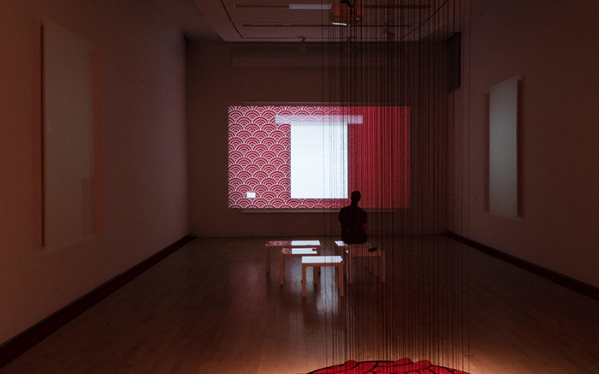 Visitor in gallery views Analia Segal's work