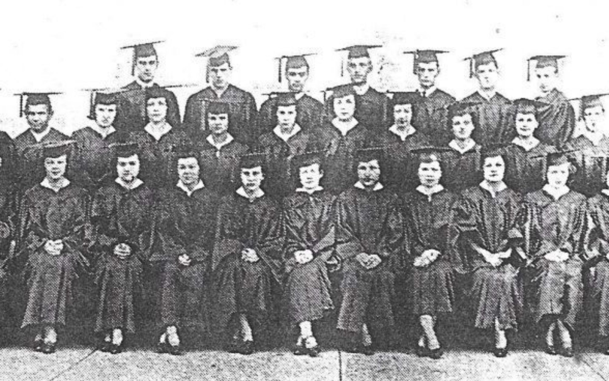 Group of high school students wearing graduation gowns