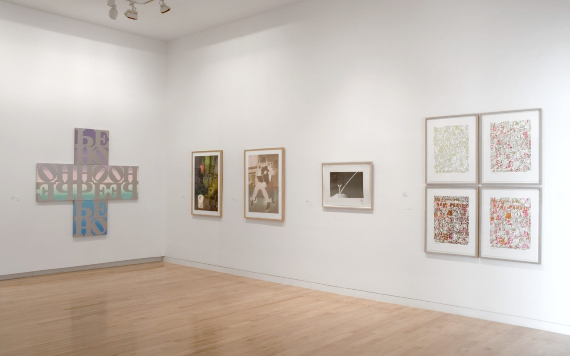 Various screen prints by Gary Lichtenstein hang on the gallery walls