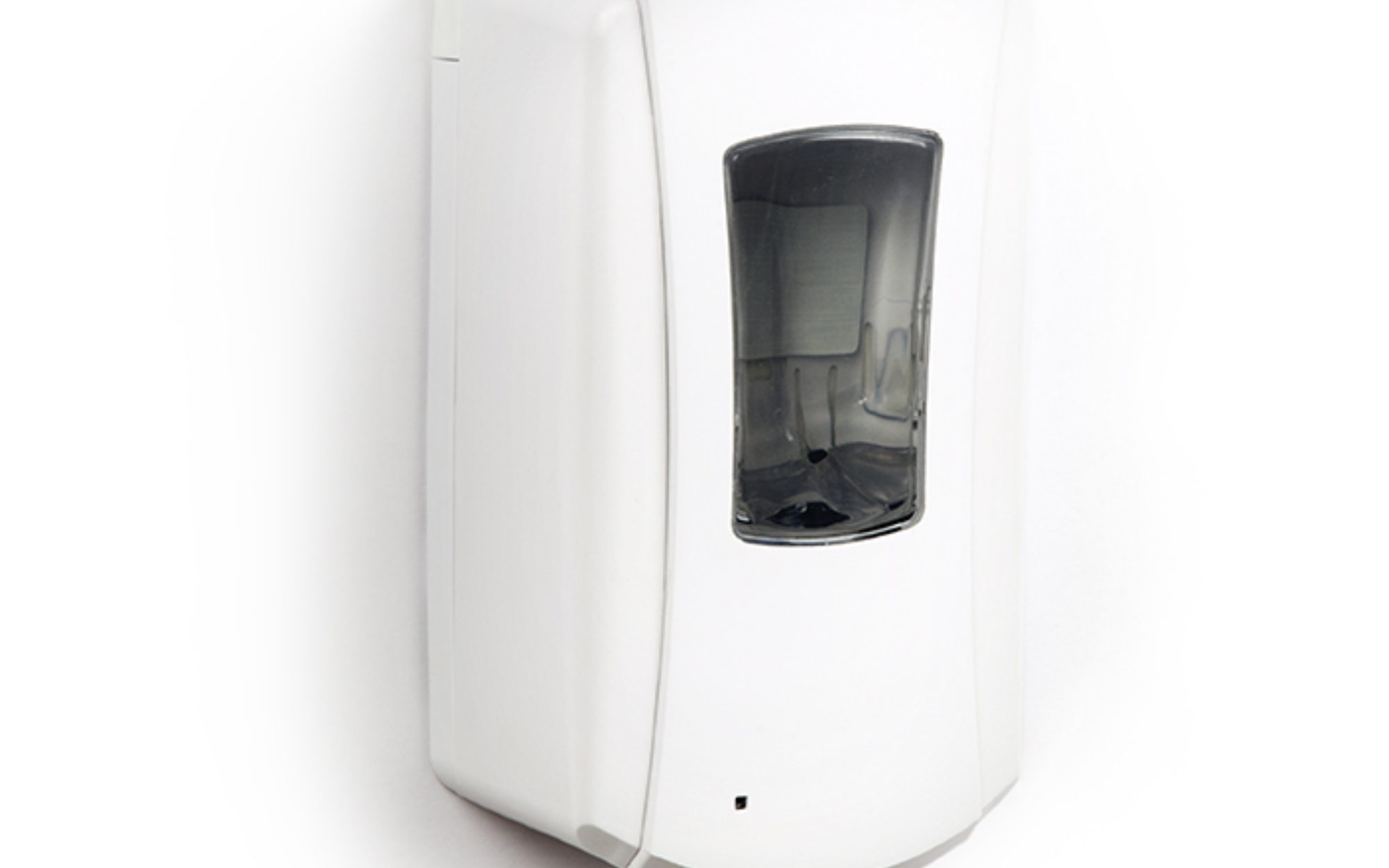 Hand sanitizer dispenser on white wall