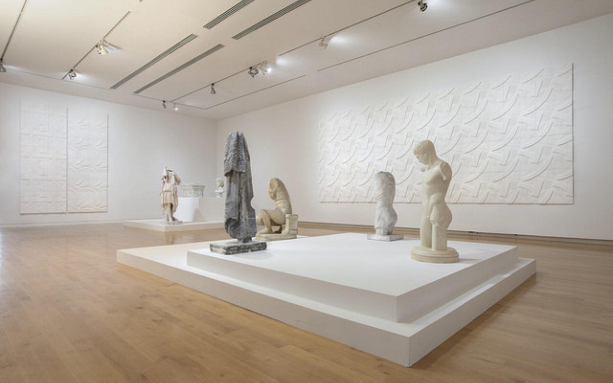 White sculptures on a platform in The Aldrich's gallery