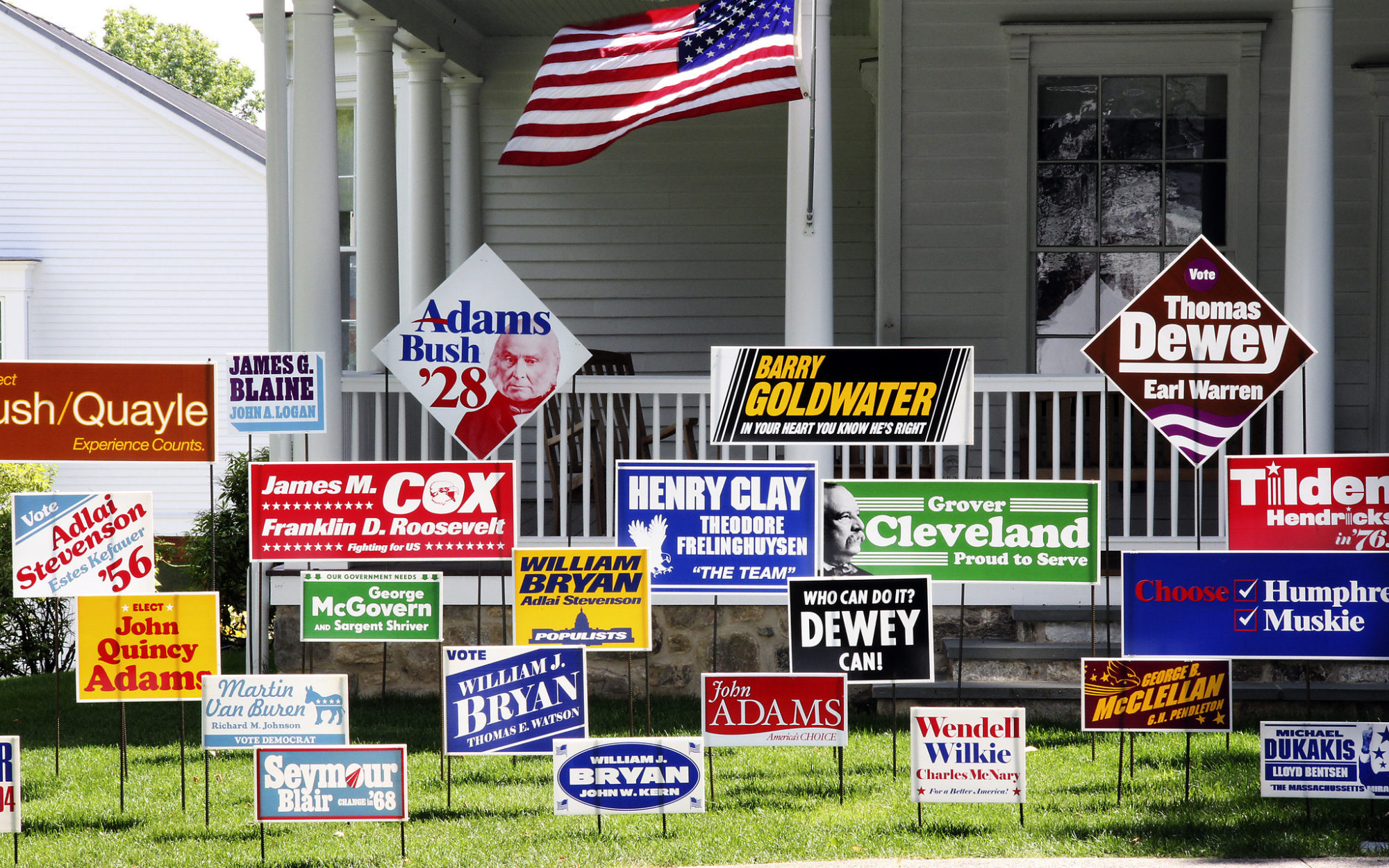 Political yard signs sit on the front lawn of the Museum's Old Hundred building
