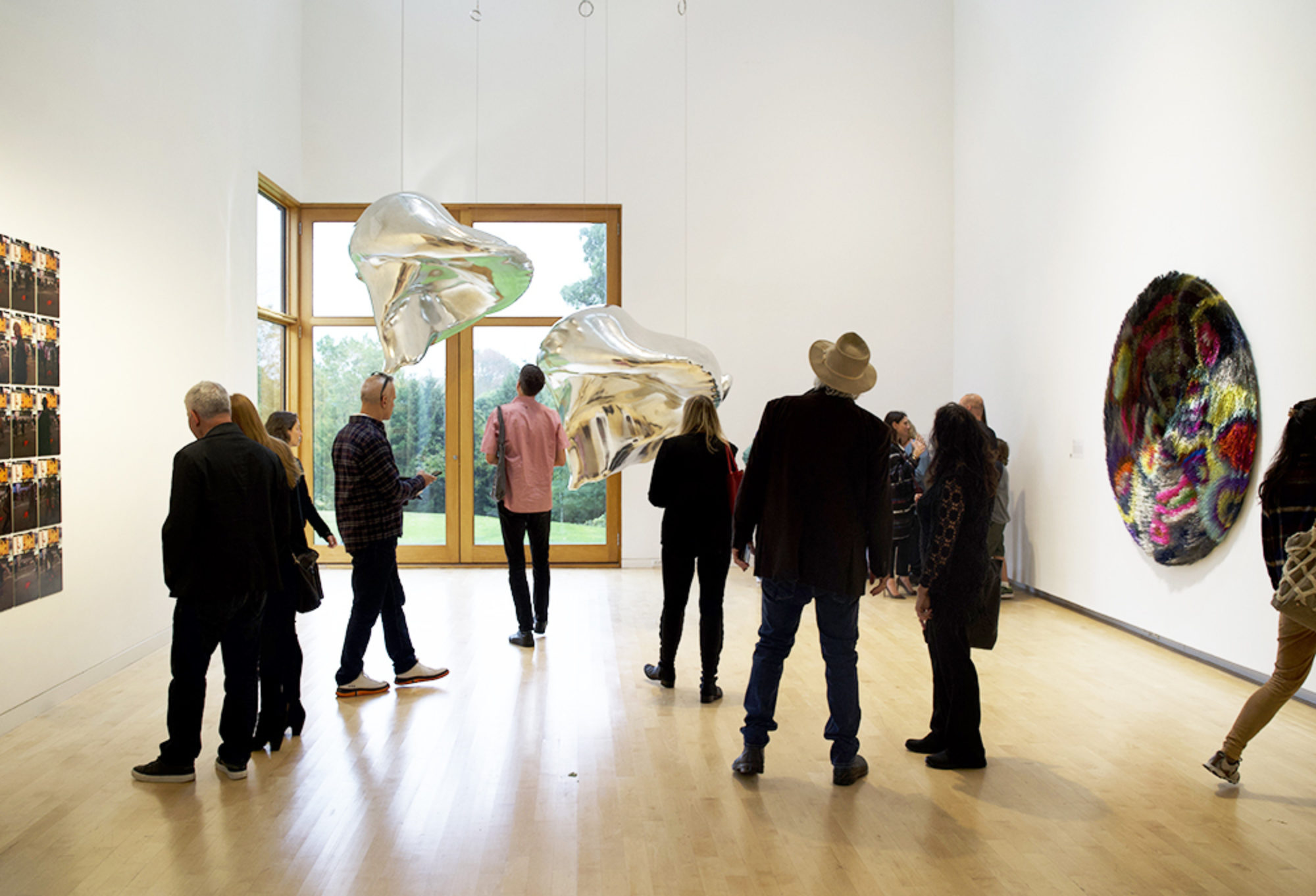 Visitors in a gallery at The Aldrich Contemporary Art Museum observing works of art on view