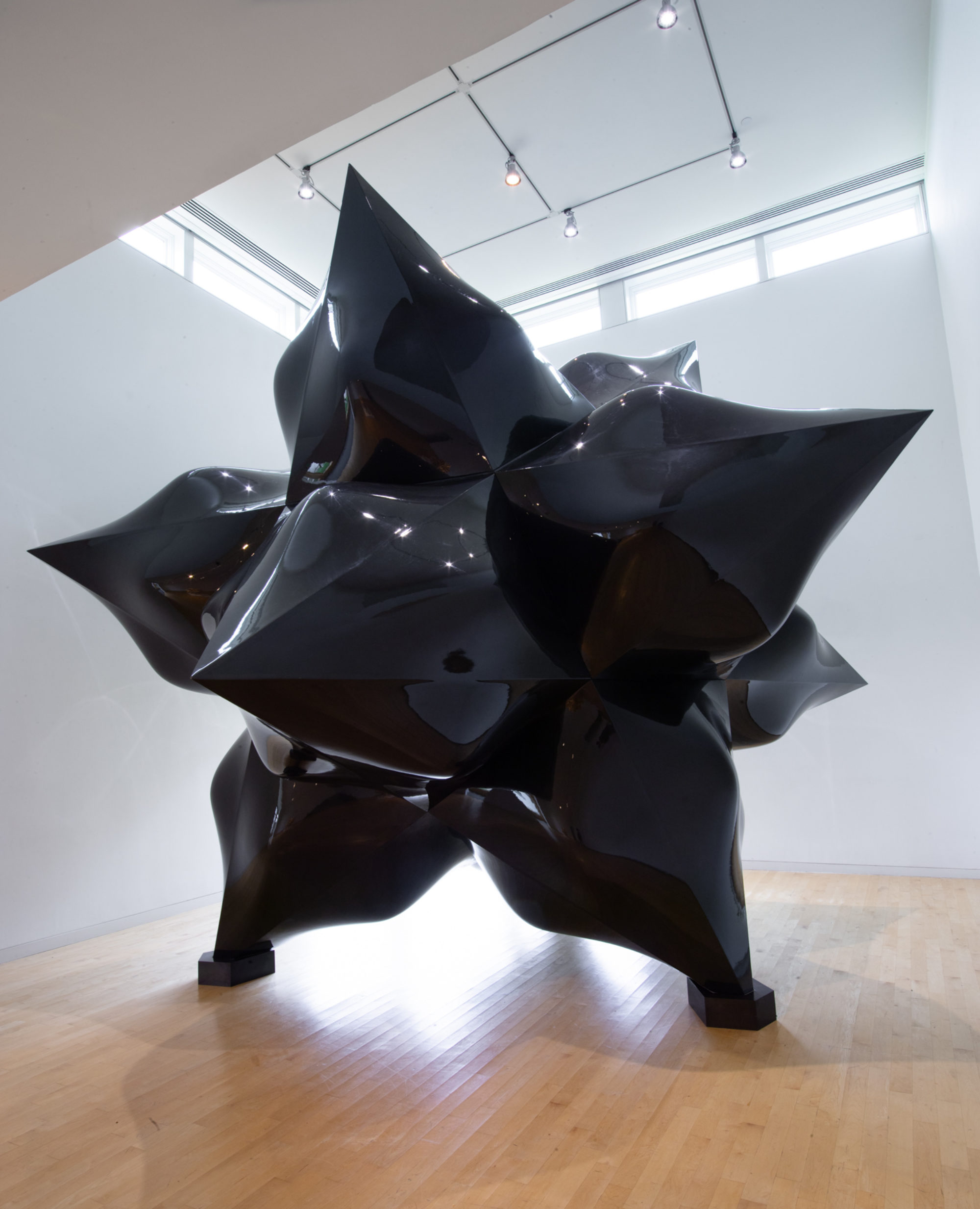Large-scale sculpture of a black star.