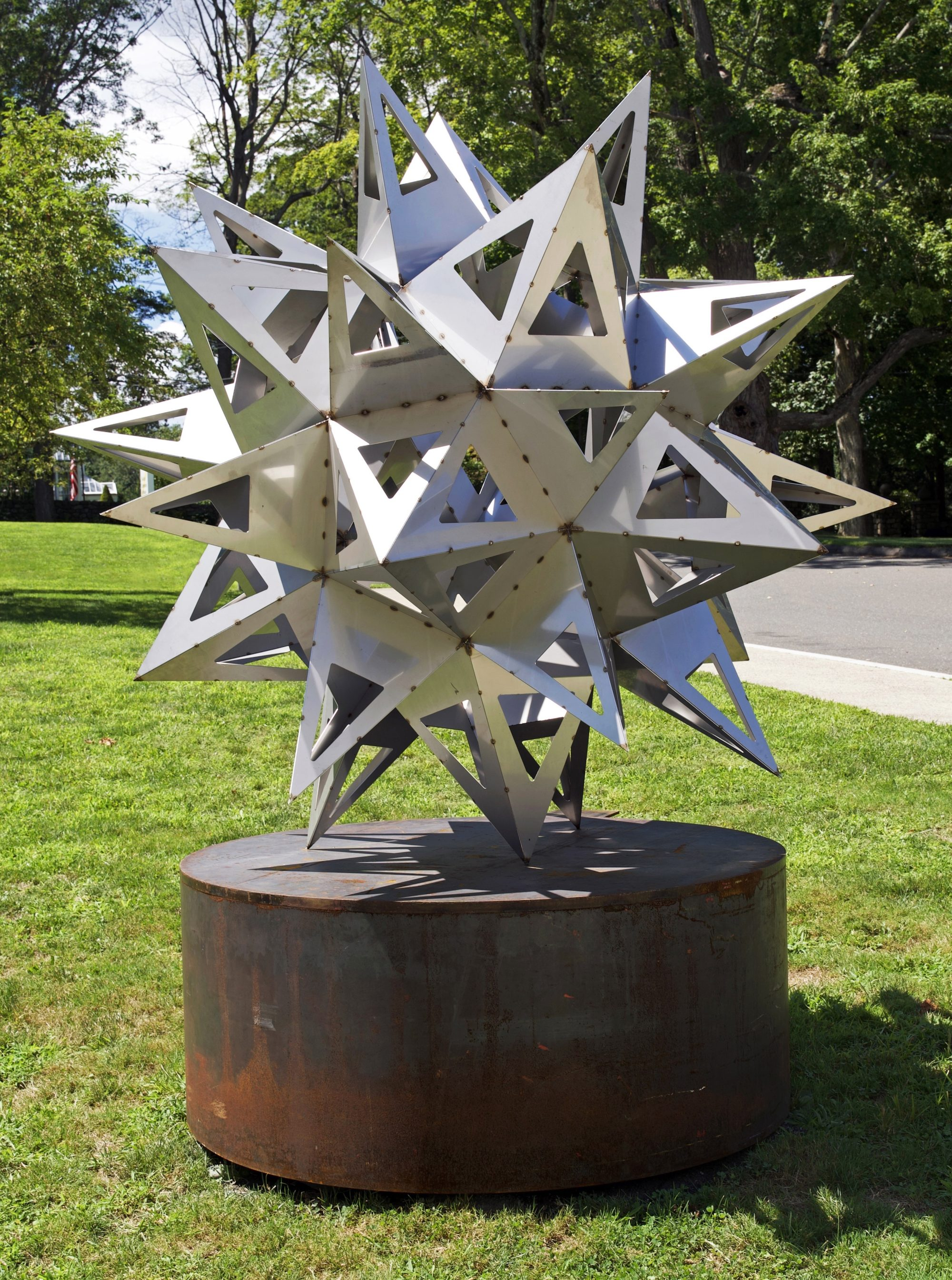 Stainless steel sculpture of an abstract star by Frank Stella sited outside on the Museum's grounds.