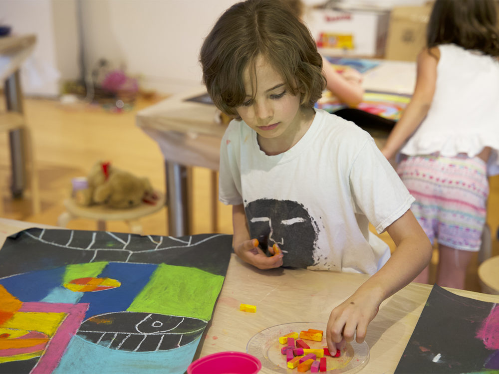 Young student creates a work of art in The Aldrich's Studio