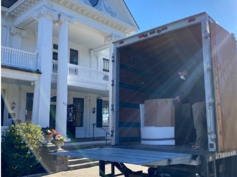 Moving truck with The Lounsbury House in background