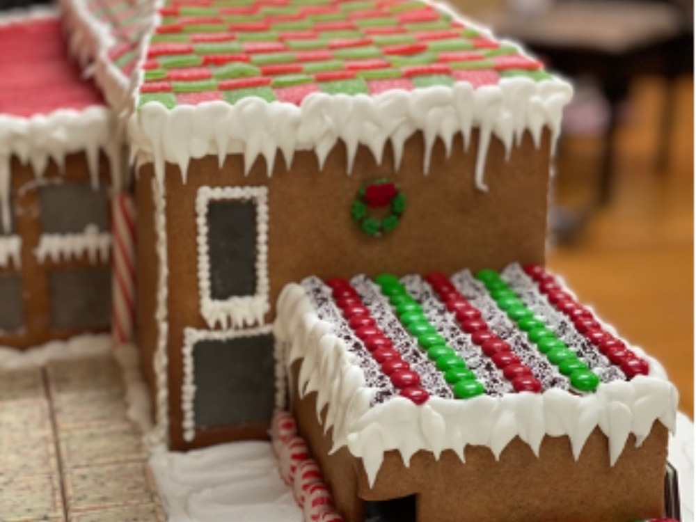 Gingerbread replica of The Aldrich Contemporary Art Museum, featuring a roof made of green and red candies