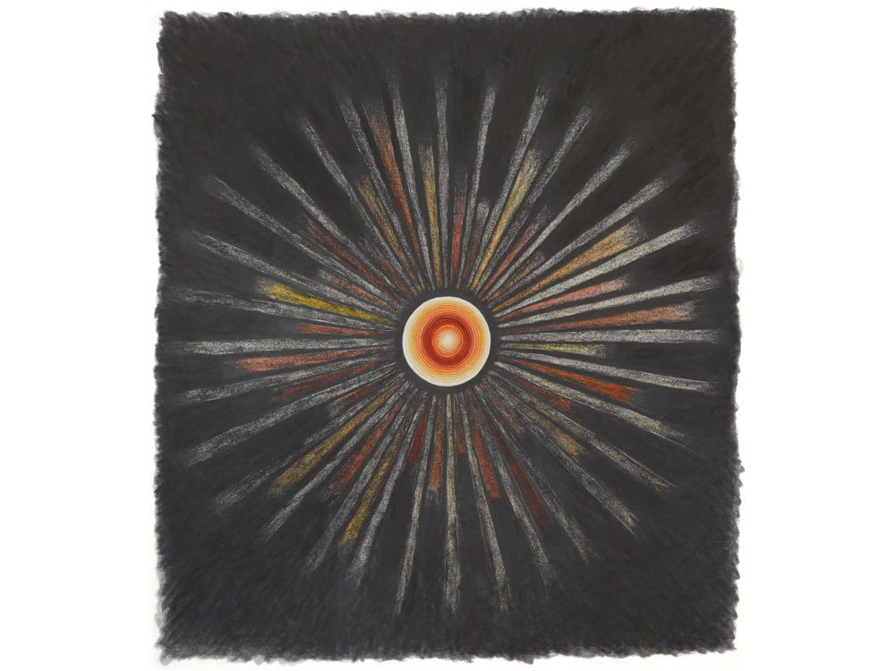 An orange and yellow circle on a black background with multi-color lines