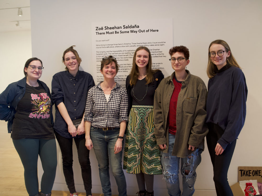 A group of Aldrich Teen Fellows pose with artist Zoë Sheehan Saldaña