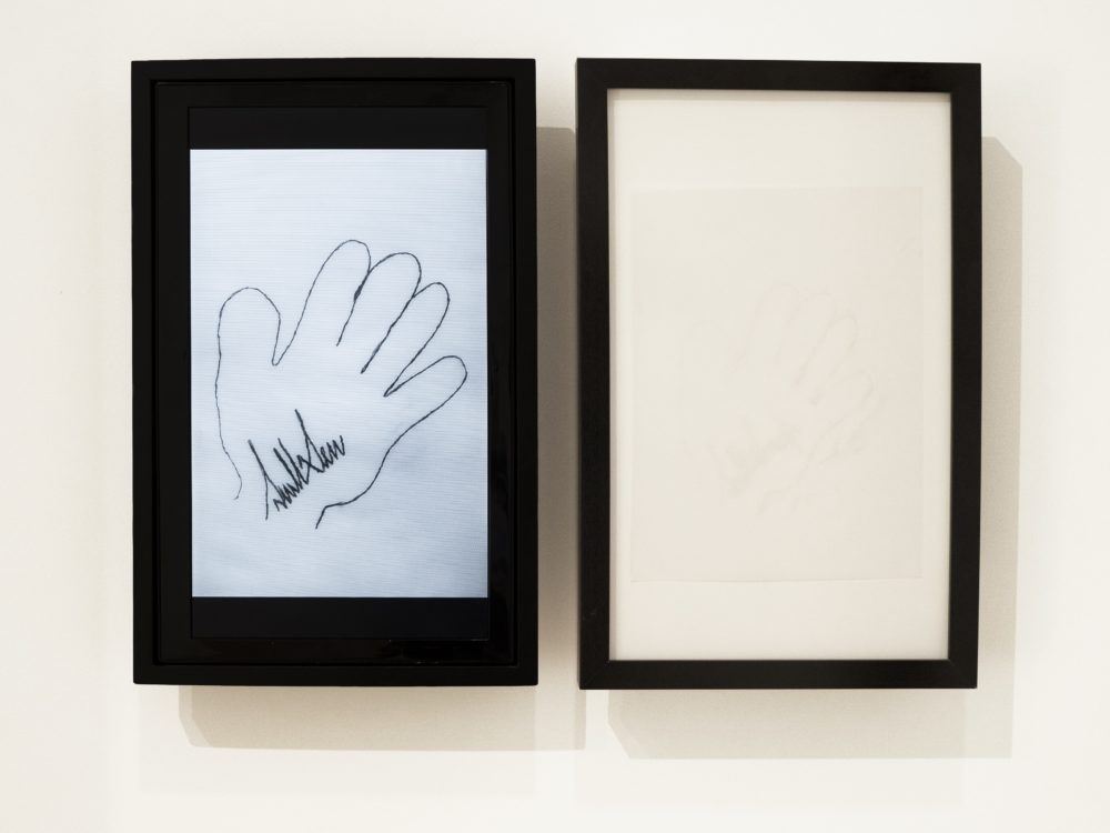 Copy of a drawing by Donald Trump of his right hand with his signature inside.