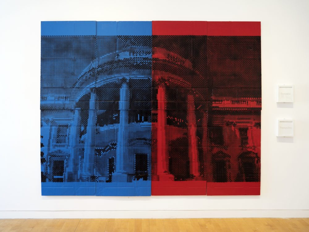 A painting of the White House façade half blue half red with two small framed works to the right.
