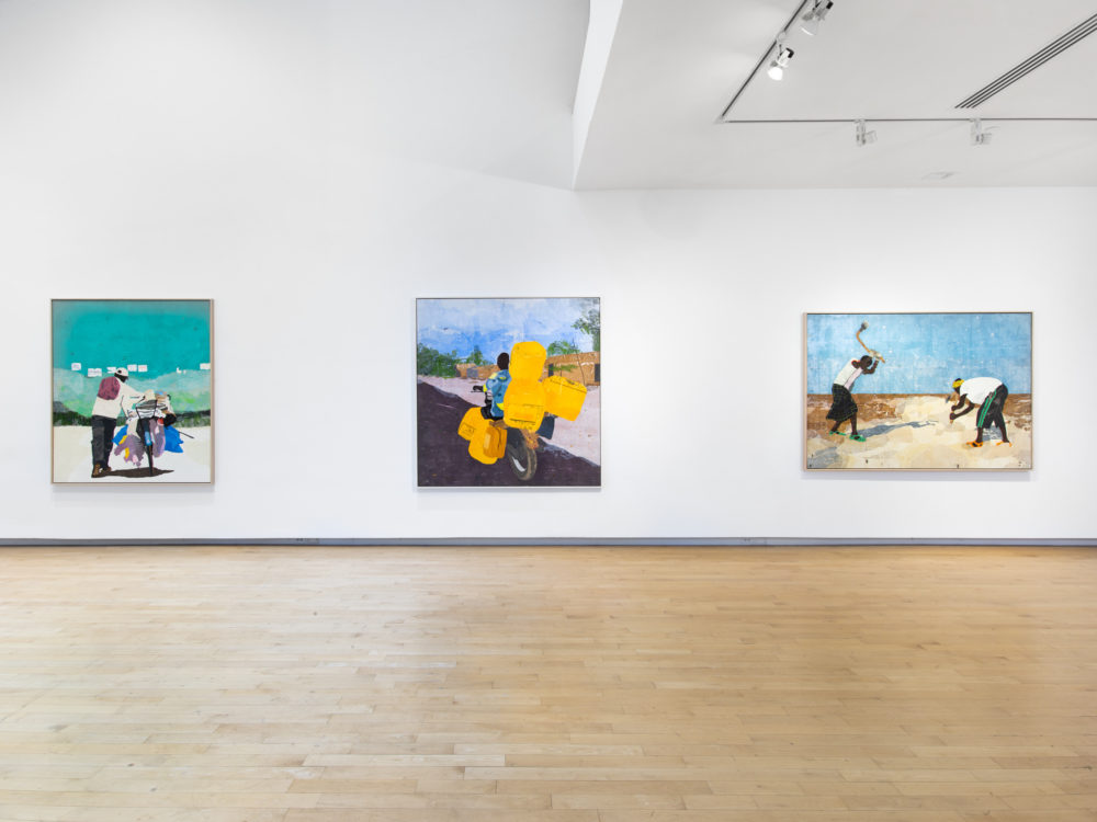 Three large canvas works on white gallery wall