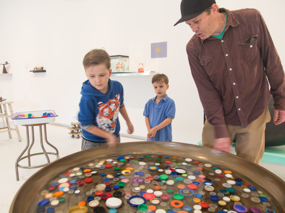 Young visitors engage with a work of art on view
