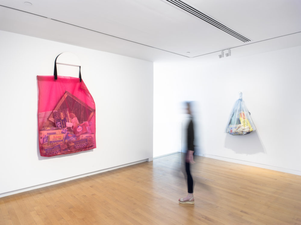 Gallery view of two large mesh bags filled with digitally printed objects