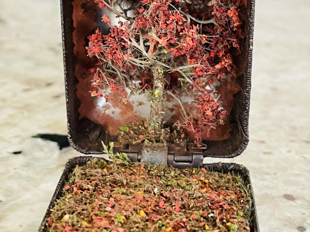 Miniature diorama crafted from a vintage jewelry box