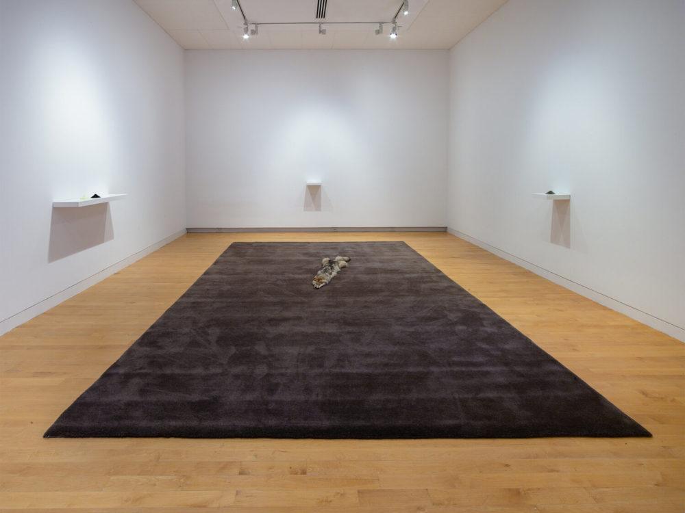 Handmade gray carpet in gallery