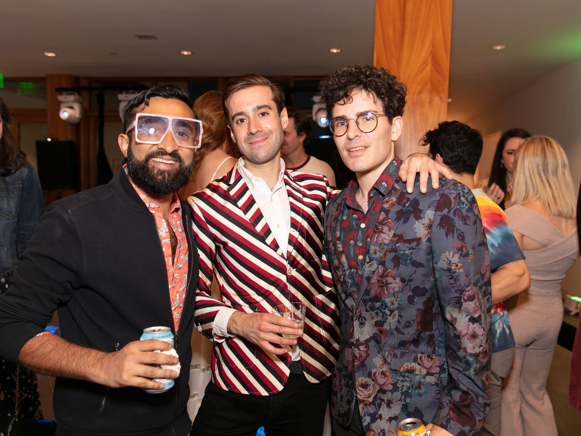 Three men at a party.