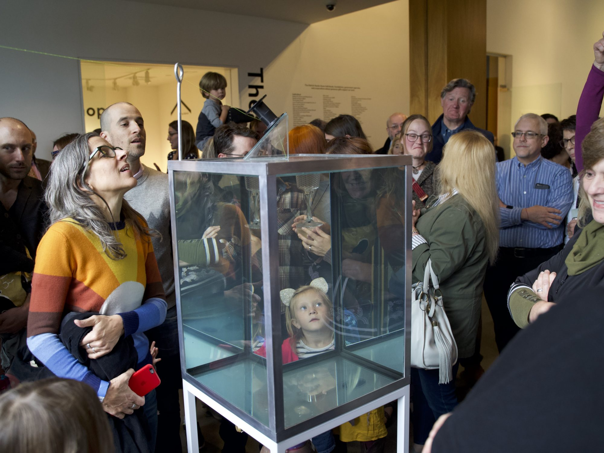 Visitors watching a performance of Sean Salstrom's Indefinity Box.