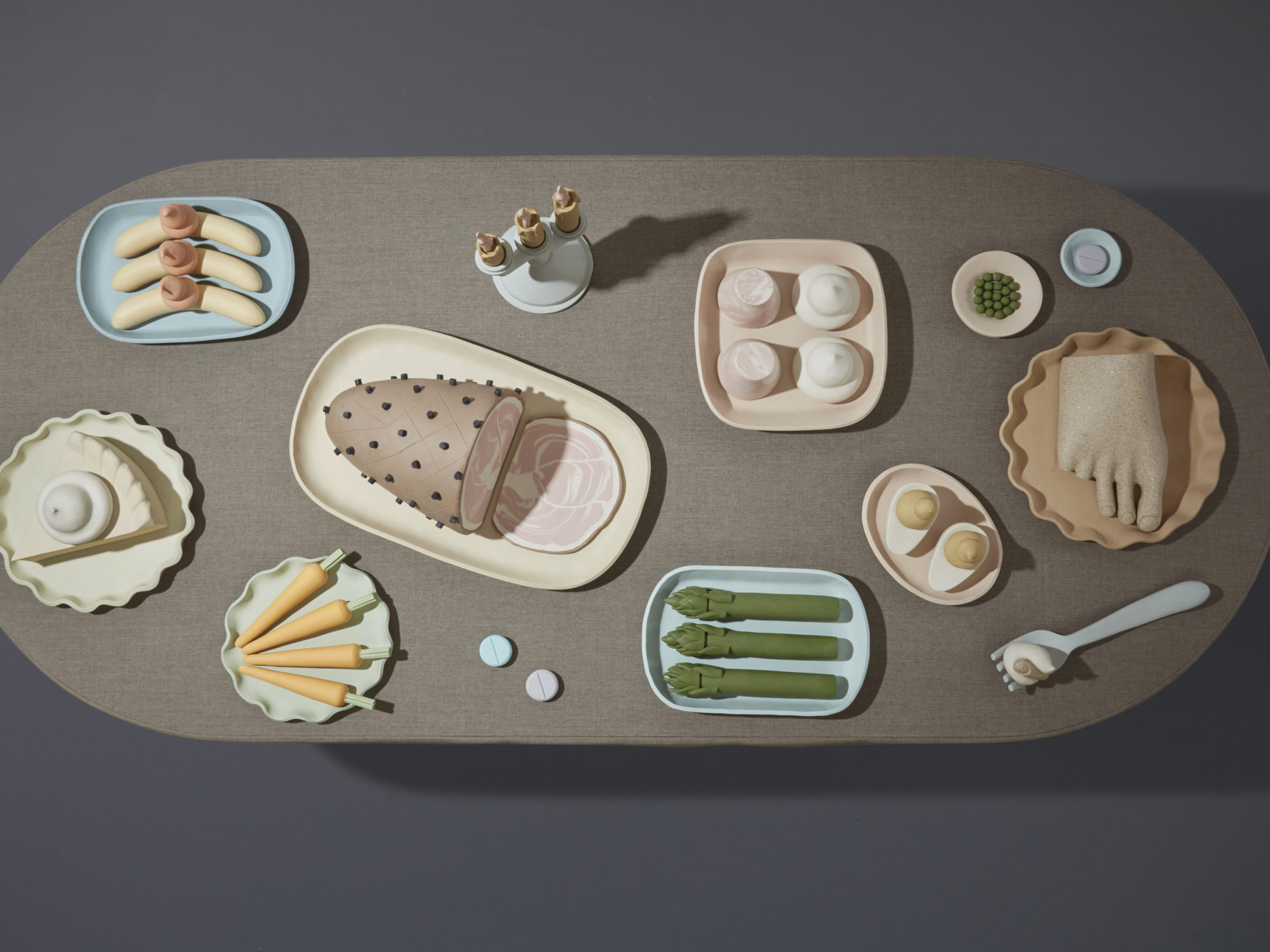 Birds eye view of sculptural objects arranged on a gray table