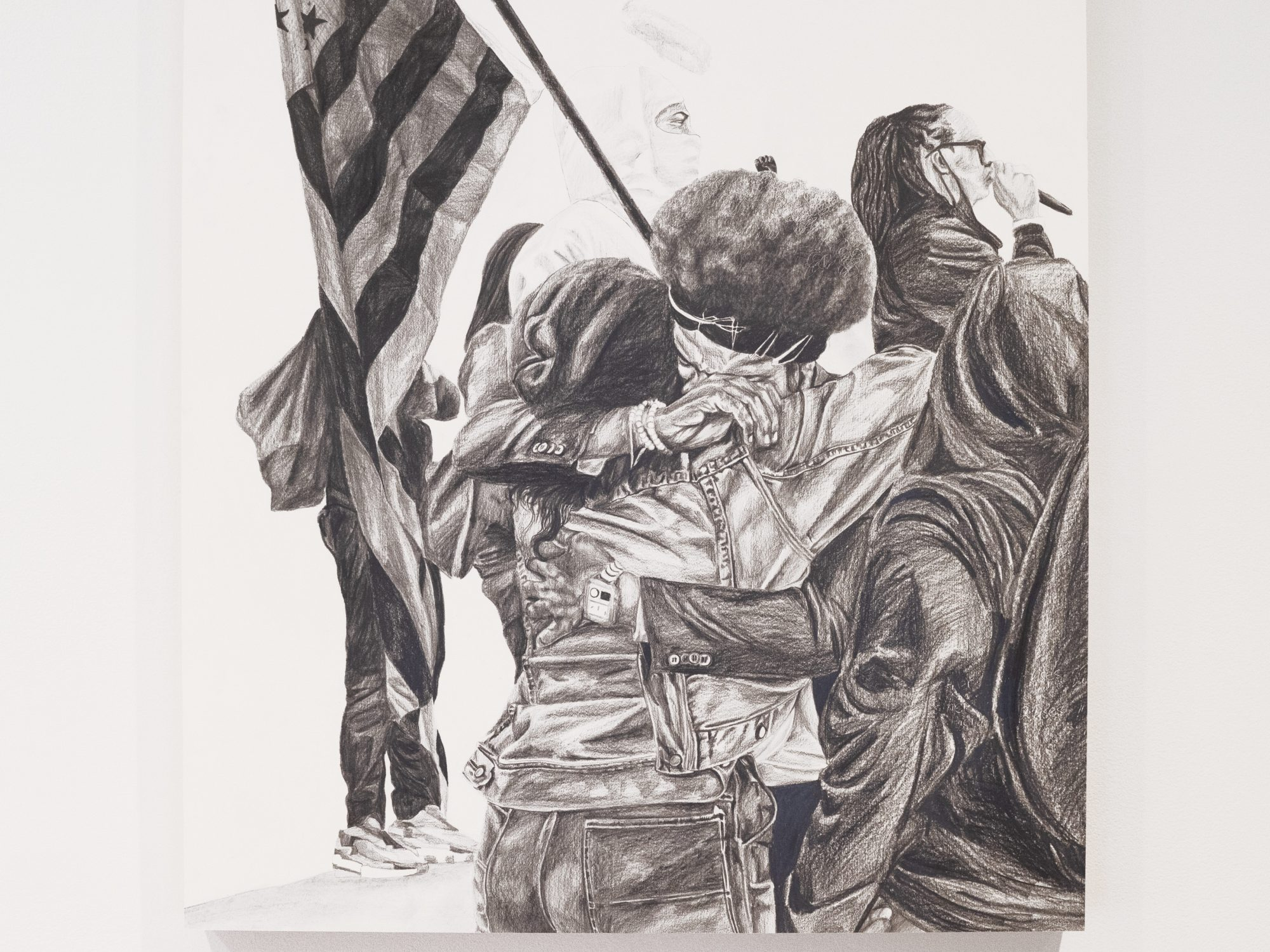 Drawing of people hugging in the foreground with a person holding an American flag in the background.